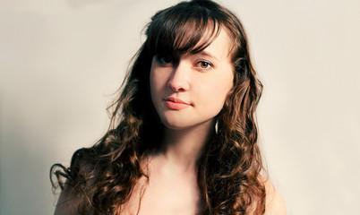 Long haired brunette in calm state studio shot