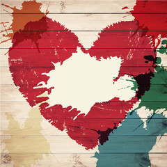 Old wooden background with watercolor heart shape and splashes