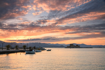 Sunset in the fishing harbour in Nafplio, Greece.
