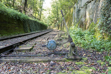 Old railroad track switch with train background