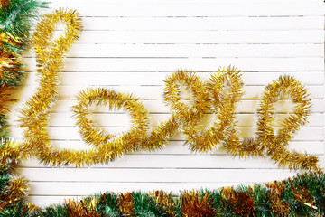 Love word formed with new year decorations on wooden background