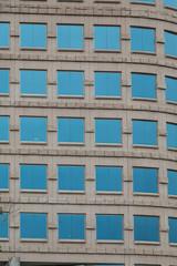 Square Blue Windows on Ornate Stone Building