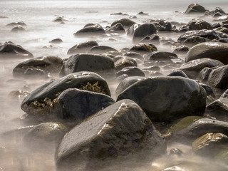 Stones in Blurred Water by Long Exposure