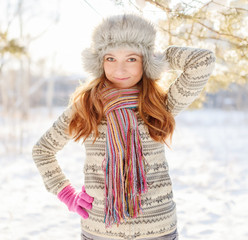 Winter portrait of young woman in fur hat