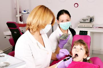 dentist nurse and child dental exam