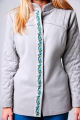 Closeup image of woman`s body wearing trendy jacket
