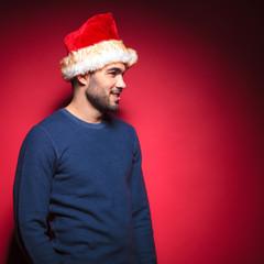 man wearing a santa hat smiling