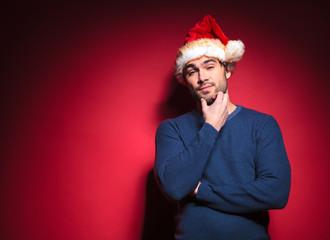 young santa scratching his beard