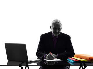 senior business man busy working  writing silhouette
