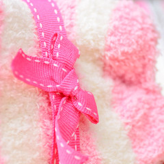 A pink ribbon tied in a bow