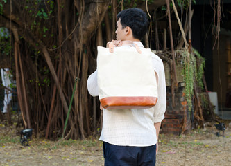 Fashion man with canvas bag