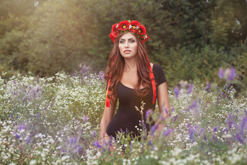 Portrait of girl in wild flowers.