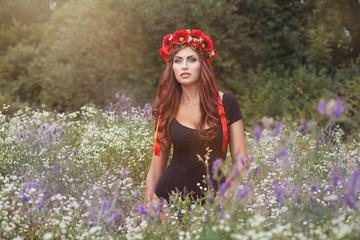 Portrait of girl in wild flowers.