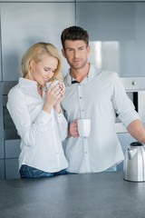 Handsome man and his wife enjoying coffee