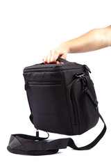 Modern Camera bag in hand on white background.