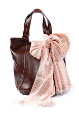 Modern fashionable female bag and scarf with tassels.