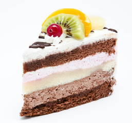 Piece of chocolate cake with icing and fresh fruit
