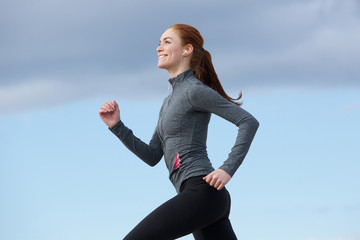 Woman smiling and running outdoors