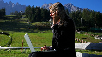 Business woman working outdoor in the mountain