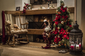 Christmas tree near fireplace