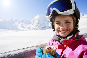 Ski, winter, child - young skier drinking hot chocolate