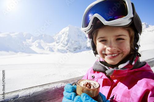 Ski, winter, child - young skier drinking hot chocolate - 71266311
