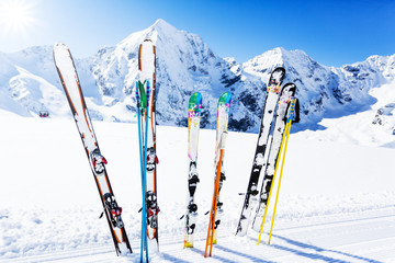 .Skiing , mountains and ski equipments on ski run