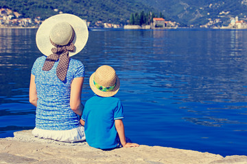 mother  and son looking at scenic view on sea vacation