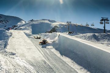 Halfpipe of Kitzsteinhorn ski resort in Austria with grooming ma