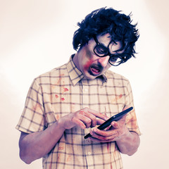 scary hipster zombie using a tablet computer, with a filter effe
