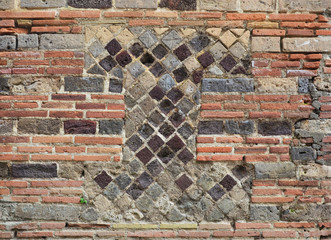 Fragment of the ancient masonry in the modern brickwall