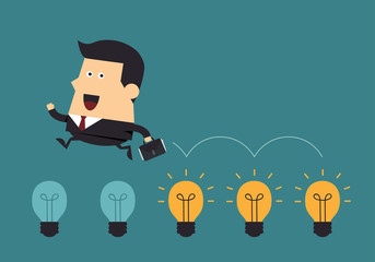 Businessman jump on light bulbs, Business concept