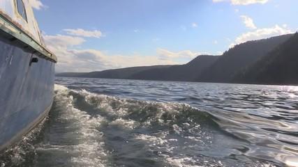 Boat sailing in the Krasnoyarsk Reservoir