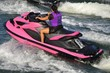 Lady on a Bright Pink Jet Ski