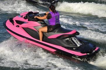Lady on a Bright Pink Jet Ski