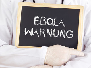 Doctor shows information: Ebola warning in german