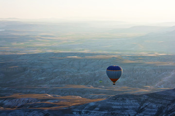 Hot air balloon flying above Cappadocia
