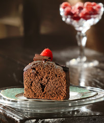 Chocolate cake slice with raspberries
