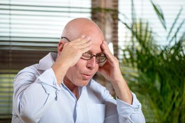 a man who has a headache