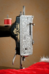 Old sewing machine with red thread