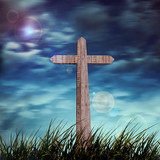 cross in a grass, sun and sunrise background