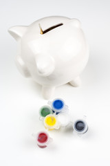 Ceramic pig with 6 colours of tempera paints and paint brush
