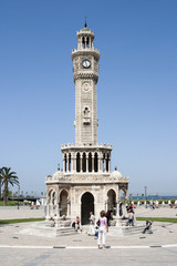 People arround Konak clock tower in Konak square of Izmir