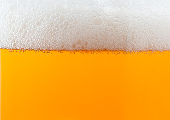 Light beer background with foam