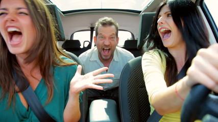 Three friends screaming in car