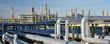 Leinwandbild Motiv Rohrleitungen in einer modernen Industrieanlage