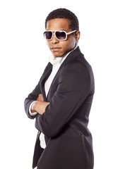 African businessman with a sunglasses and arms folded