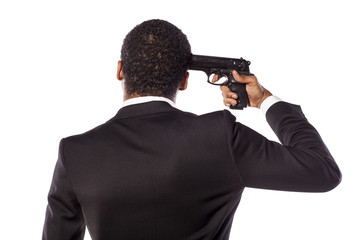 African businessman making suicide with a gun
