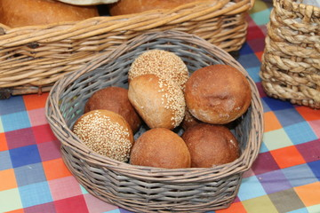 A Wicker Basket of Freshly Made Round Bread Rolls.