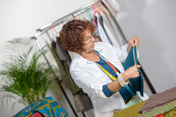 middle-aged dressmaker working in his workshop